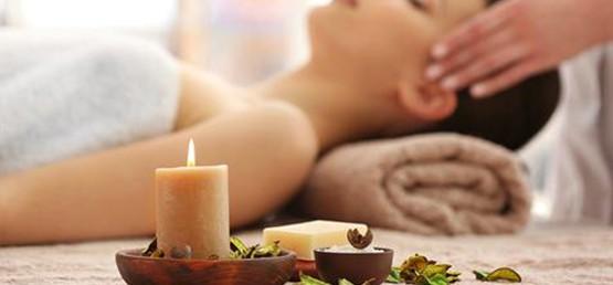 Woman receving an aromatherapy massage.